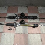 old power steering rack (top) and new manual steering rack (bottom)