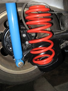 rear suspension with modified axle beam and upgraded springs