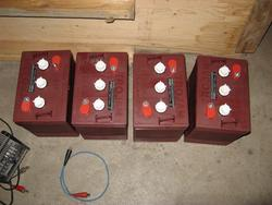 Four more Trojan T-105 batteries, to be installed in trunk.