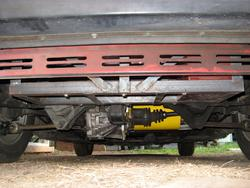 Trunk battery rack uses space underneath the trunk formerly occupied by exhaust system.