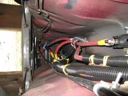 Battery cables in the tunnel section under the car.  Breaker and Ammeter shunt visible.