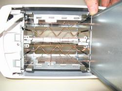 Bottom view of toaster with crumb tray openned.  Serious air flow potential is evident.